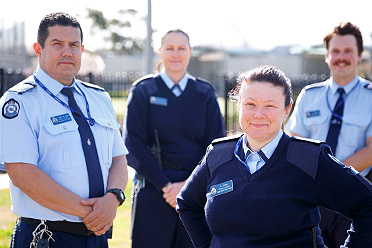 Two female and Two male prison officers standing outside.