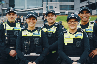 A line of five male and female police officers