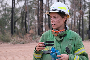 Become a forest firefighter, Woman pictured in firefighter equipment drinking water.